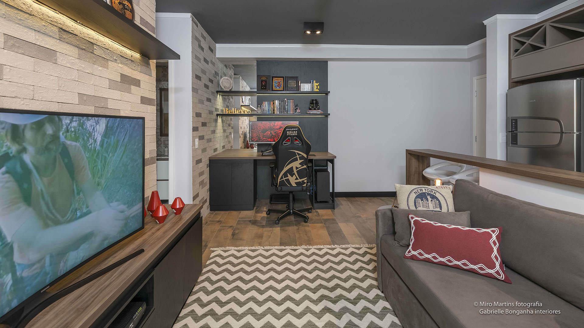 apartamento pequeno com móveis planejados home theater